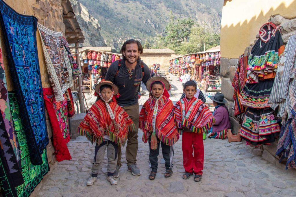 WanderWithUs-Peru-SacredValley-Ollantaytambo-NeilWithLocalBoys